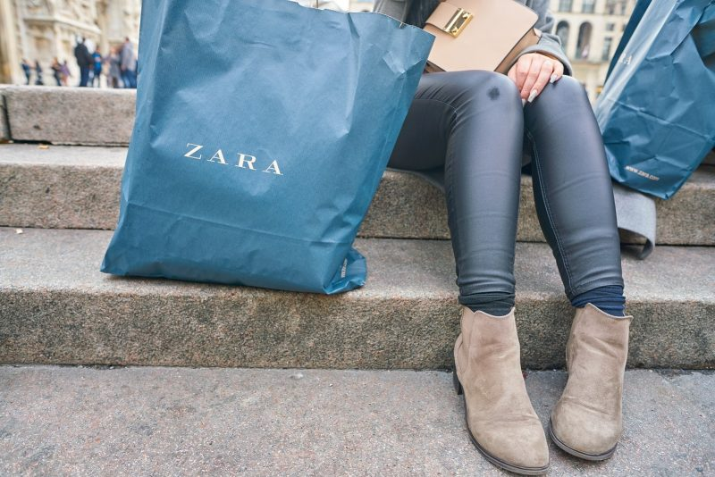 woman with a Zara branded shopping bag in Milan