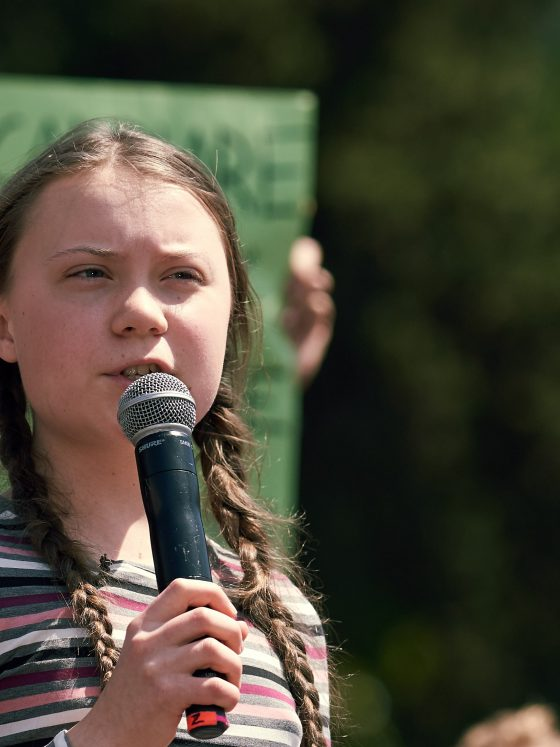 ROME, ITALY - April 19, 2019: Swedish climate activist Greta Thunberg attending Fridays For Future (School Strike for Climate) protest in front of a huge crowd near the Colosseum