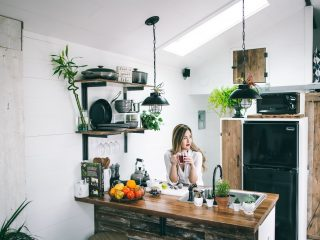 woman sitting in front of table in a spring home with plants