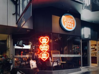 The storefront of Auckland's gourmet pizza joint, Proper Pizza.