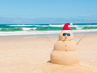 Snowman Made Out of Sand at The Beach