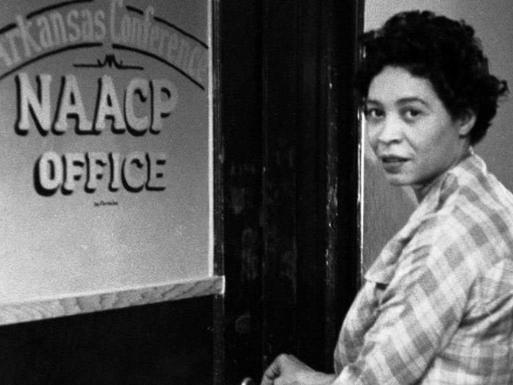 Daisy Bates standing outside of the NAACP Office.