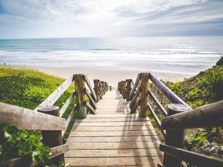 view of new zealand beach from a boardwalk