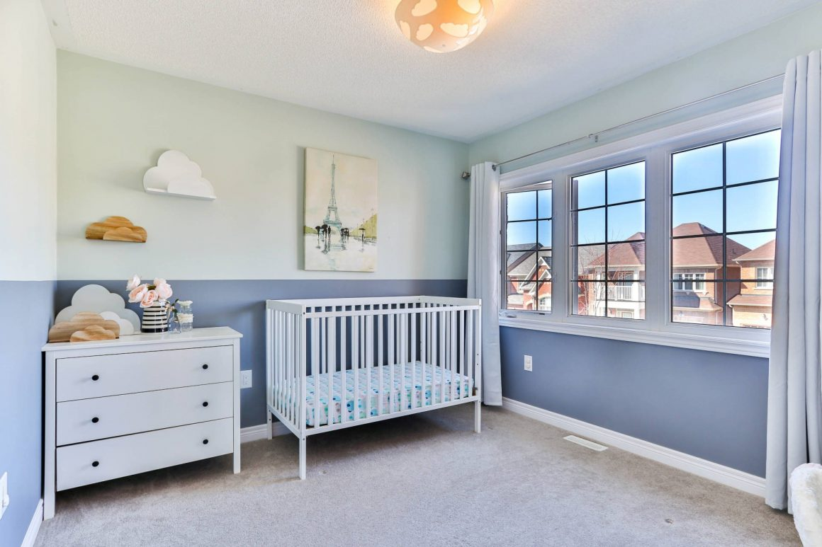 baby room with blue walls